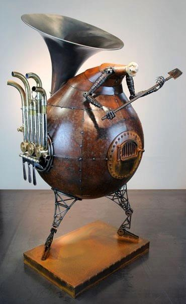 """Artist:Greg Brotherton  Sounding the Furnace  2010  Size: 33 """" x 14 """" x 16 """"  Materials: Welded steel, concrete, french horn"""
