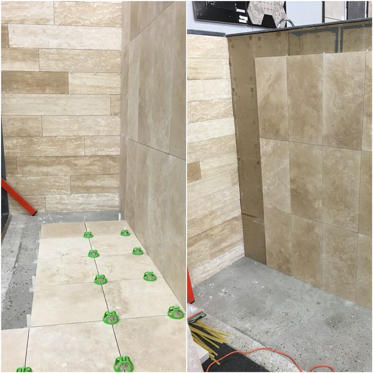 New display coming along nicely, using honed and filled travertine, with our new travertine plank feature wall.