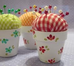 Cute pincushion from a very small terra cotta pot, painted...hmmm...think I would use the saucer too, if there is one that small....Hobby Lobby, JoAnn, here I come (this would be cute for little girls to make!)