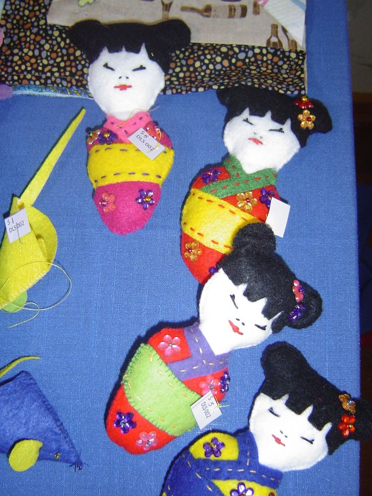 My little Geisha girls and at the left finger puppet mice.  I will get a better picture of them later.