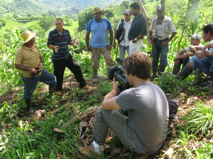Adam - creator of Up In Smoke - filming visiting farmers at Faustino's plot.