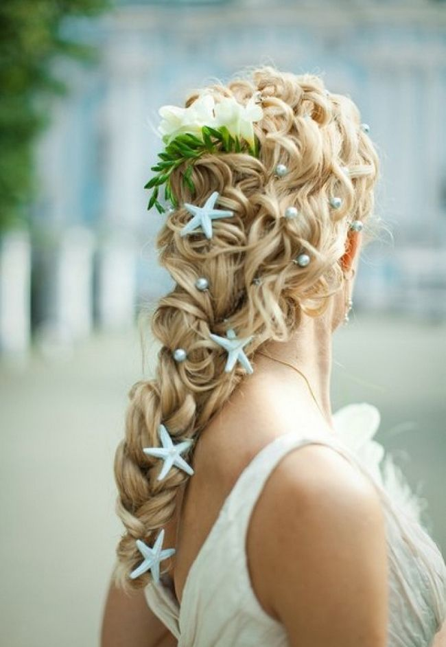 hairdo braid with blue starfish decorations and pearls
