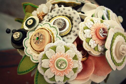 Felt bridal bouquets by Princess Lasertron (Omaha) and owner and bridal designer Megan Hunt... amazingly creative designer. And makes a truly durable keepsake!    She likes to use buttons that have a special meaning to the bride or groom... nice additional touch!