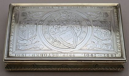 """A lovely commemorative Scottish silver box, beautifully engraved on the lid with 3 different armorials. The sides of the box are decorated with an attractive flower, leaf and bow design, and the interior is silver gilt. The inscription reads """"From Friends at Archers Hall to Charles Stewart, Match Secretary, 1891-1901, 22nd October 1901."""" Archers Hall was built in 1777 for the Royal Company of Archers, the oldest surviving company of longbowmen in Britain. Today a private club, they provide…"""