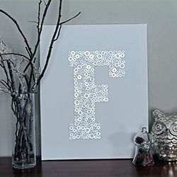 Make your own artwork using washers to create a beautiful monogram! Easy and inexpensive!