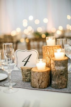 candles on tree stumps centerpiece for wedding