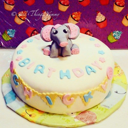 Cartoon Cakes - Elephant Cake | Pastel Cake with Blue and Pink Fondant Birthday Message and Baby Elephant | All Things Yummy #allthingsyummy #fondant #pastel #cartoon #cakes