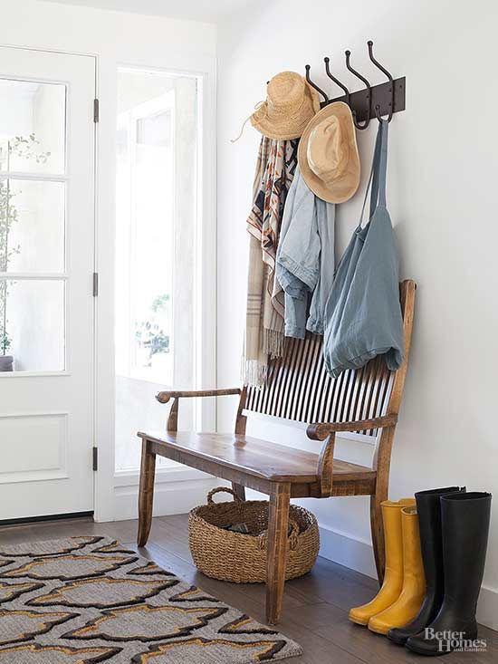 Turn the space by the back door into a mini mudroom. Adding a few hooks, a bench, or a boot tray keeps often-used items neat and accessible.