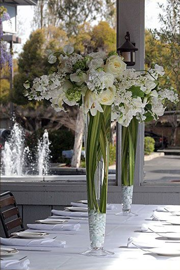 """A spring mix of white flowers, namely stock, roses, rununculous, ecuadorian """"polo"""" roses and white sweet pea. Created by Pico Soriano."""