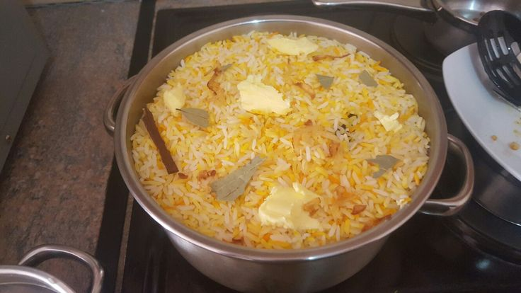 Step 2: layer par-boiled rice. Add saffron, bayleaves and cinnamon sticks. Cover with foil and place in preheated 220deg oven for an hour and a half.