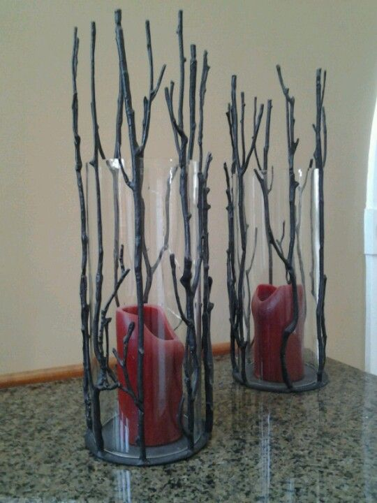 Awesome candle holders. Could make these with tall clear glass vases/candle holders then glue fake sticks on them