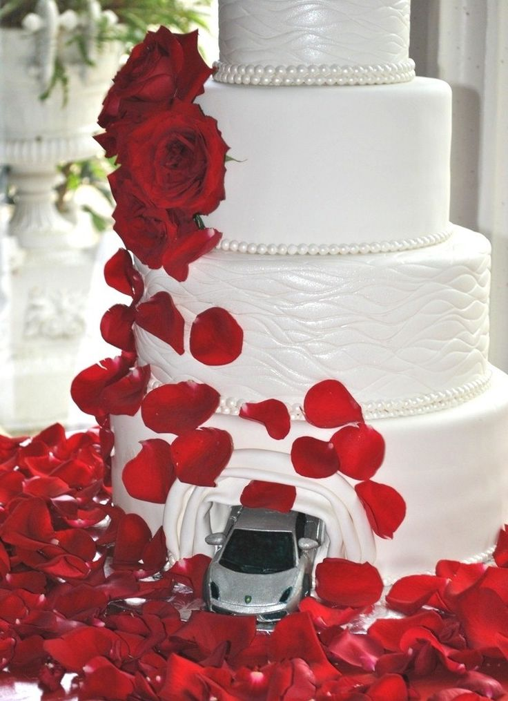 Chocolate Lamborghini car is coming out the 4 tier wedding cake...His favorite car! Surprise!...so cute!