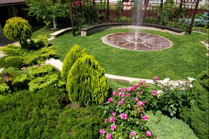 I like the pergola, with the center fountain, the flowerbeds except for the arbor vitae, not a huge fan, it gets a bit over grown but like the variation of greens interspersed with flowers: