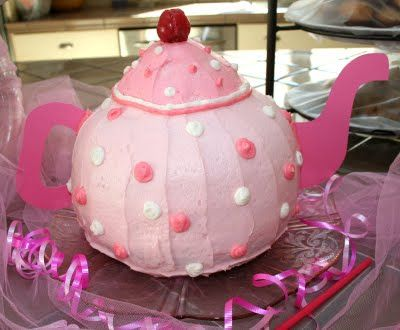 Use a giant cupcake mould for the cake and use card to make the spout and handle