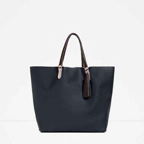 10 Fun Tote Bags We Love-Cute and Colorful Totes for Women-Trade out black for navy and brown. This Zara tote bag is made from colorblocked polyurethane that looks just like real leather, but for less. Browse our selection of affordable totes at redbookmag.com.