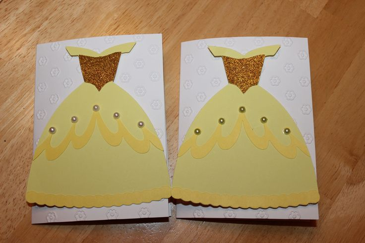 "My daughter's ""Belle of the Ball"" birthday party invites made with the Cricut. Embellished with pearls (or ""diamonds""). Bodice is cut out of glitter paper. Card embellished with my cuttlebug and dress adhered to the card with puffy double sided tape to give the card some dimension."