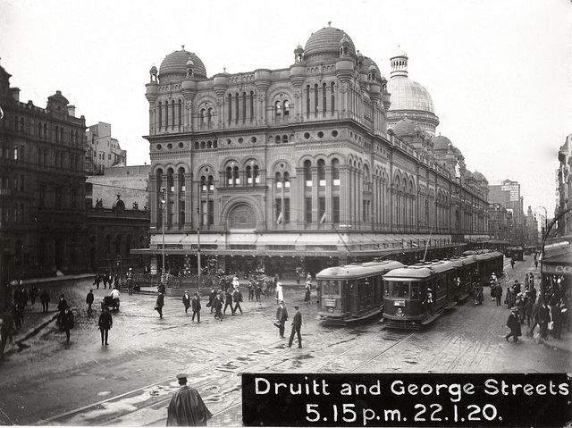 Trams operating on George Street, Sydney - showing the Queen Victoria Building - Druitt and George Streets, Sydney 5.15pm, 22 January 1920