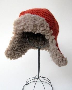 fleeced earflap hat.  extreme thrumming.   bulky yarn and fleece.  cocoknits.