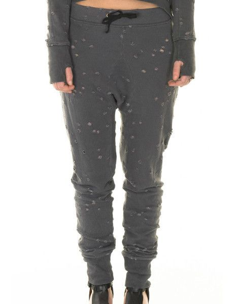These cool distressed pants from Tusnelda Bloch are a stylish choice for everyday wear.     Drawstring waist, and a ribbed ankle.      This soft pair is best teamed with a slouchy top, sumptuous cotton tees and silk shirts for sophisticated leisure.    80% destroyed cotton    20% polyester  #Futuristic #fashion #minimalistic #danishdesign