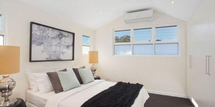Generous double bedroom, built ins, glass louvres, 100% wool carpet