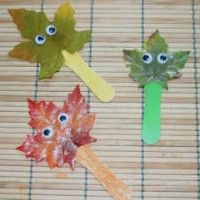 Fall Crafts! Leaf stick puppets using artificial leaves.