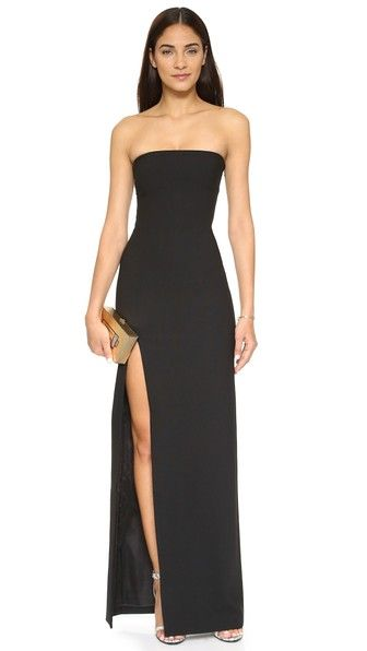 Elizabeth and James Seiler Gown |  A minimalist Elizabeth and James strapless gown with a deep front slit. Nonslip rubber binding at top hem. Hidden side zip. Lined. #black