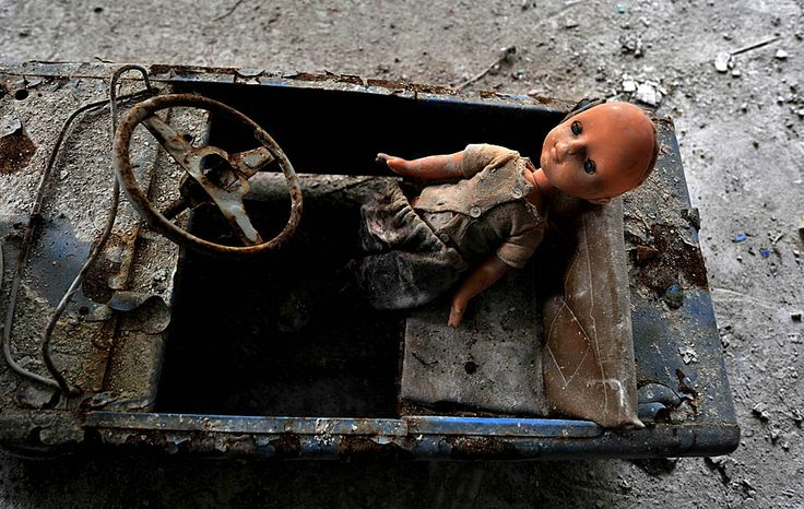 A plastic doll rests in a rusted toy car at what was once a kindergarten in the ghost town of Pripyat.: Toys Cars, Rust Toys, Abandoned Place, Ghosts Town, Dolls Rest, Dark Dolls, Plastic Dolls, Ghosts Dolls, Paddles Cars