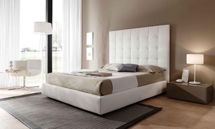 Dormitorio moderno con cabecero tapizado