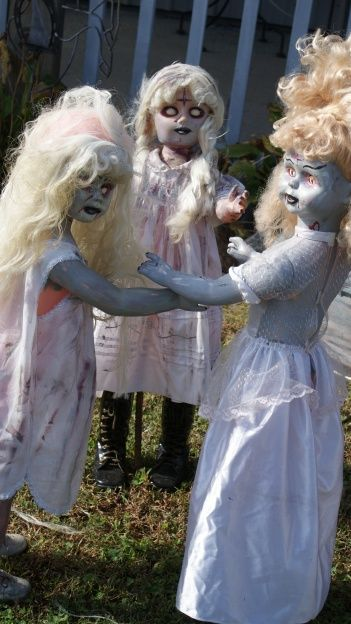 dolls from the Goodwill store -- oh I like this idea!!!  CREEPY !!!!  I am doing this in my yard if I can find the dolls!!