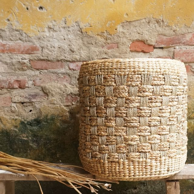 Drum Pouf  --- Handwoven Seagrass | Water hyacinth | Corn Husk Leaf  --- Mekong River Collection Being inspired by the beauty of river, our artisans sketch it on their rugs, poufs and baskets with various stripes patterns created by different weaving techniques on mixed natural fibres.