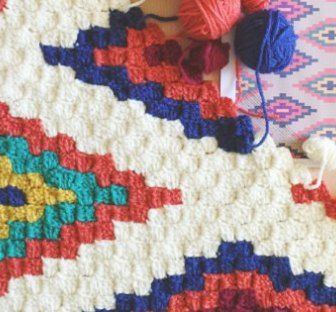 Do you enjoy Corner to Corner (C2C) crochet? This Southwestern style throw caught our eye this week. The design is 100% perfect for the C2C technique – the blocks look great. This design looks really challenging, but it's so easy, you'll be surprised! If you've gotten the hang of C2C crochet, and you can follow along a graph, this blanket is not going to be hard for you. The hardest part is managing the yarn, but even that wasn't as big of a deal as I originally thought. C2C is a crochet…