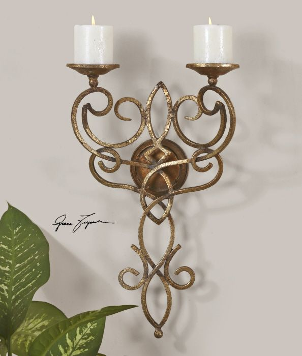 This Wall Mount Candleholder Is Made Of Hand Forged Metal With An Antiqued  Gold Leaf Finish. Off White Candles Included
