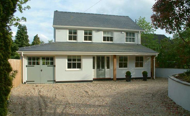 a 1960s home given an external makeover with grey render