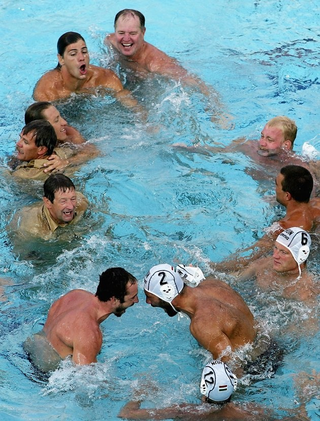 Inspirational Moments: Olympic celebrations - ATHENS - AUGUST 29: The Hungarian team celebrate afer winning the gold medal in the men's Water Polo gold medal game against Serbia Montenegro on August 29, 2004 during the Athens 2004 Summer Olympic Games at the Main Pool of the Olympic Sports Complex Aquatic Centre in Athens, Greece. (Photo by Daniel Berehulak/Getty Images for FINA)