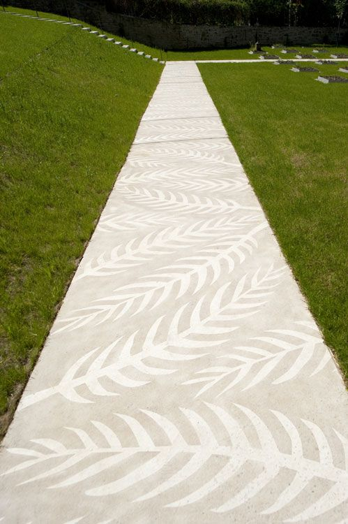 Concrete walkway with stained(?) palm frond design. Old Graveyard Leinefelde by…