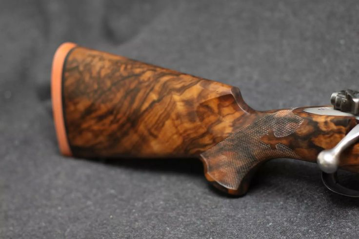 Exhibition Grade Turkish Walnut on Pre 64 Winchester Model 70. Fleur de Lis hand checkering.