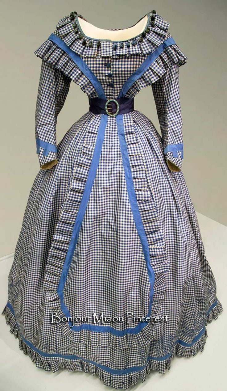 A gingham silk taffeta gown ca. 1865, with an 18-inch waistline. FIDM via Irenebrination
