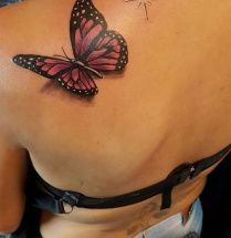 Vlinder op schouderblad