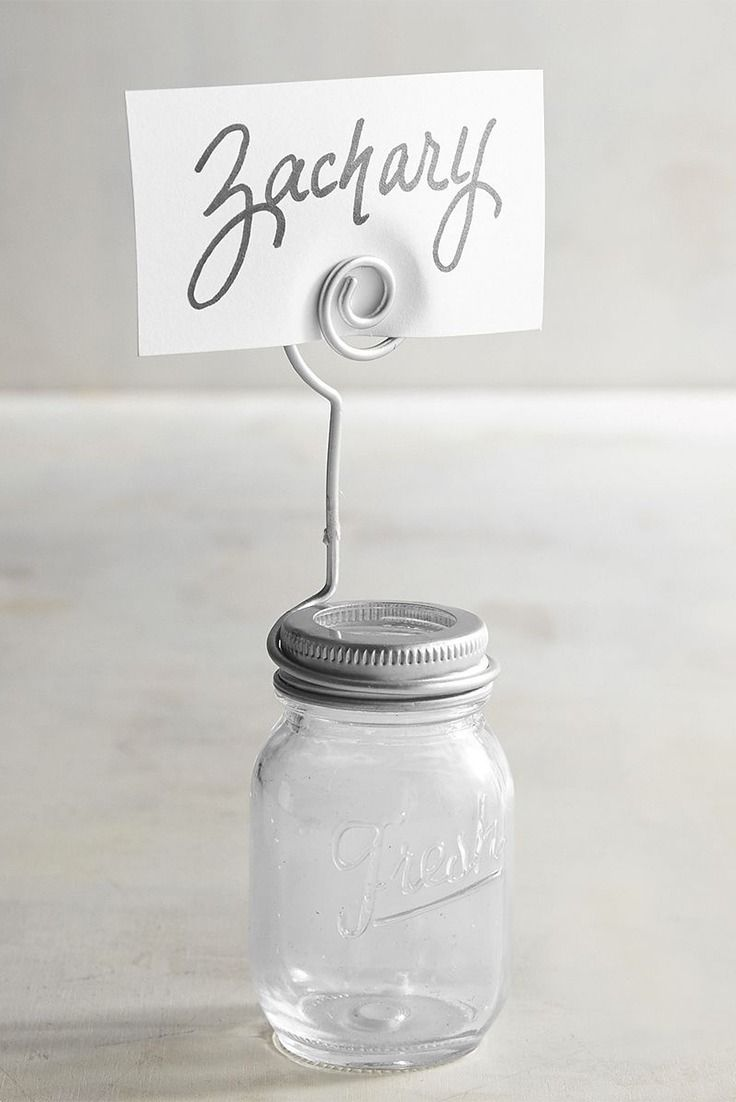 The farmhouse look is trending in homes, so it only makes sense to apply it to your wedding reception. Mason Jar Place Card Holders from Pier 1 pull double duty by making sure everyone is in their proper places—but doing it with laid-back country charm. For an added treat, fill them with candy that matches your color scheme.