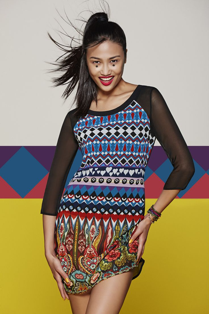 A lightweight straight fit dress with an ethnic print. It has a zipper at the back and semi-sheer sleeves.