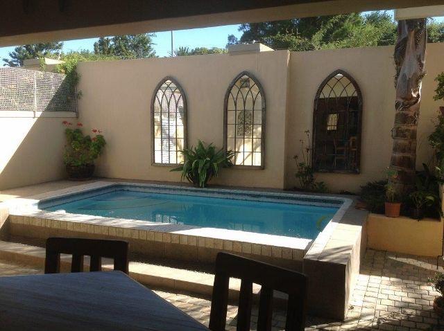 Back yard with splash pool