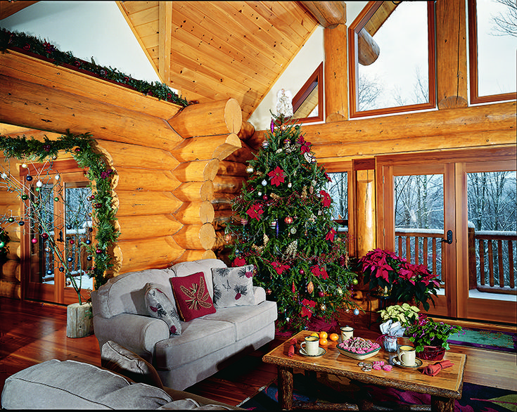 Love both trees - the traditional one in the corner and the simple branches near the door with glass balls. So cute!