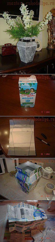 Jarrón con tetrabrick de leche y papel