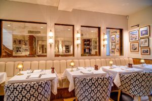 Chucs. Sophisticated interiors and quiet elegance on Westbourne Grove.  Chic and smart. Think Harry's Bar Venice. Has a lovely outdoor garden.  https://www.chucs.com/dine-at-chucs
