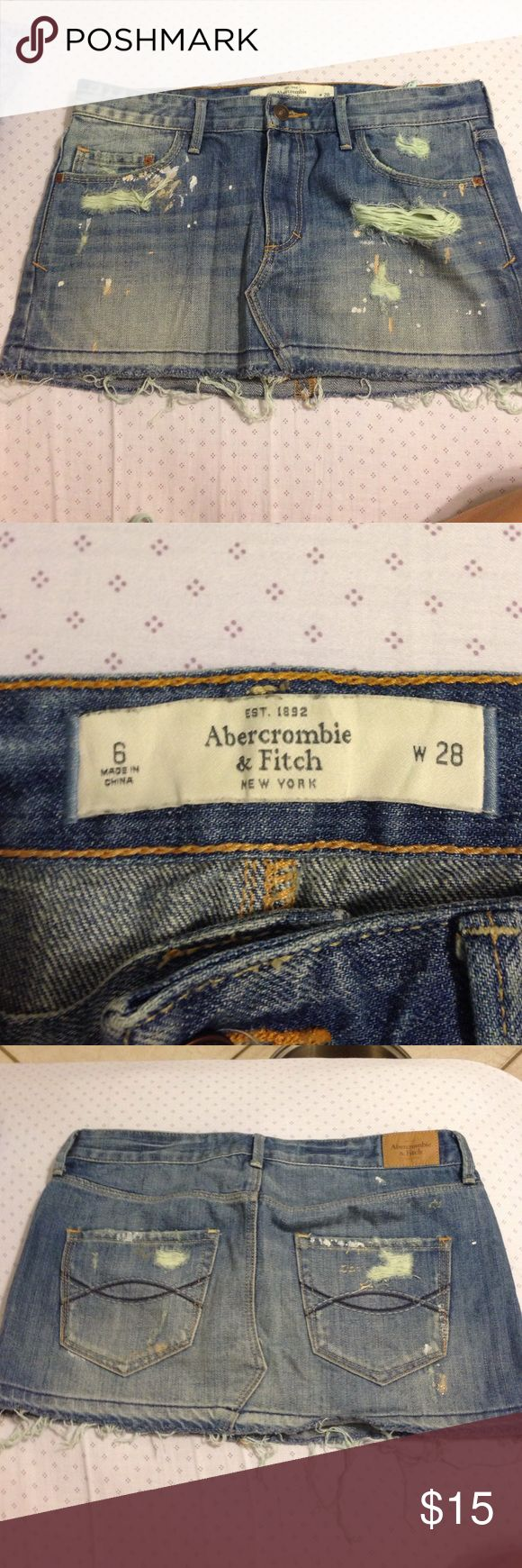 """Abercrombie and Fitch Jean mini skirt size 6 / w28 Abercrombie and Fitch mini skillet torn look with pockets and zipper. Greenish tint to the """"torn"""" parts. Great condition size 6 or women's 28 Abercrombie & Fitch Skirts Mini"""