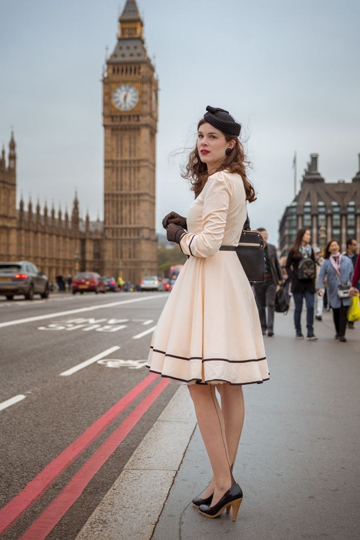 RetroCat wearing a vintage inspired dress and fully fashioned stockings in London/UK