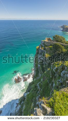 http://www.shutterstock.com/pic-218230327/stock-photo-cape-point-landscape-located-near-the-city-of-cape-town-south-africa-the-peninsula-has-towering.html?src=l2UmwzKl67EMHu1DgRoo8g-1-25 Cape Point Landscape, Located Near The City Of Cape Town, South Africa. The Peninsula Has Towering Rock Cliffs That Overlook The Beautiful Ocean View. A Tourism And Travel Hot Spot. Stock Photo 218230327 : Shutterstock