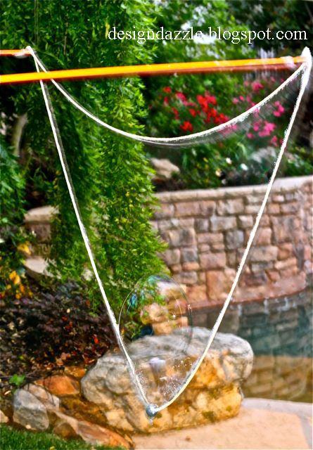 giant bubble wand  1. 2 peices of dowel  2. 2 eye hooks  3. a washer (to way down the rope)  4. cotton rope (spotlight, lincraft, craft store)  have fun :D