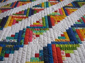 Quilter: Michelle's Log Cabin Quilt I want to make a log cabin quilt, and this one is beautiful!