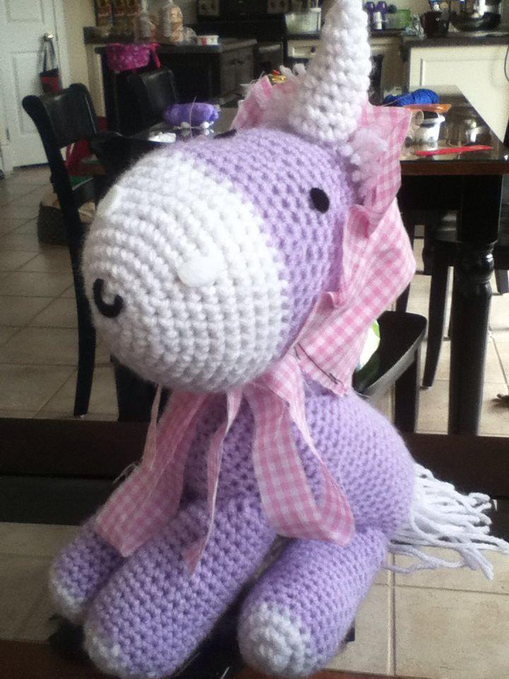 A purple fluffy unicorn in a bonnet!